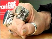 Rings on Jacqueline's fingers