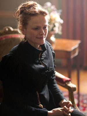 Maxine Peake, as Miss Anne Lister, sits in a chair