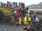 Competitors and spectators at the Stone-skimming championships, Easdale