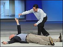 Craig Barrett and person lying on floor playing dead