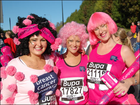 Runners in pink outfits