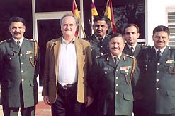 Sir Mark Tully with members of the current Indain Army