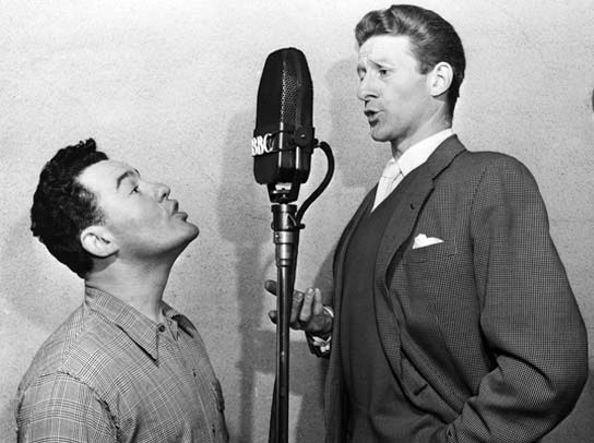 Jon Pertwee and Kirk Stevens at a BBC microphone, 1955.
