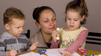 A mum and her children doing arts and craft together © Jandrie Lombard @ Fotolia.com