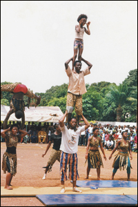 Members of a Sierra Leonean acrobatic team celebrate the 48th anniversary of Guinea's independence.