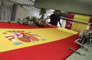 This factory near Madrid has churned out 50,000 flags for Spain fans - REUTERS/Juan Medina