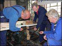 Dave, Charlie and Tim working on an old boat