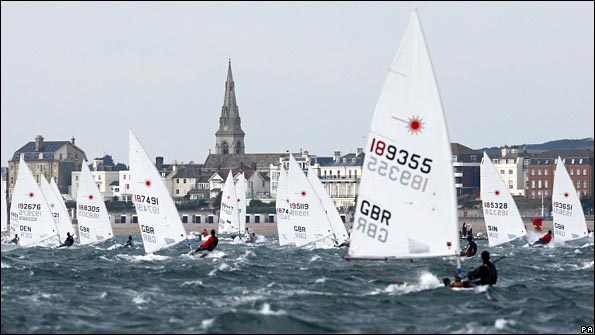 The men's Laser fleet head down wind towards Weymouth during the Skandia Sail for Gold Regatta