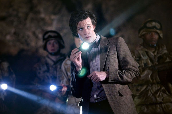 Matt Smith as The Doctor looks around a cave in The Time Of Angels episode