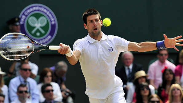 Novak Djokovic returns a shot in his men's final with Rafael Nadal at Wimbledon 2011