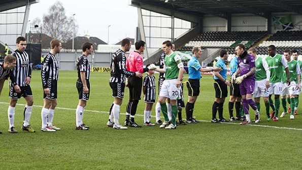 The St Mirren and Hibs players shake hands before their league match in February, perhaps to introduce themselves to one another... Photo: SNS.