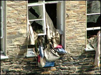 August 2004 - Belongings hang from broken windows.