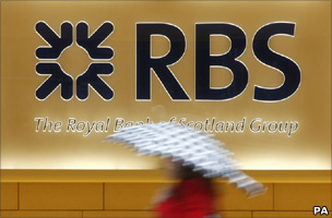 Lady walks past RBS sign