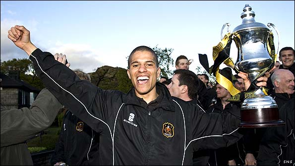 The late Gordon Lennon celebrates winning the Third Division with Dumbarton