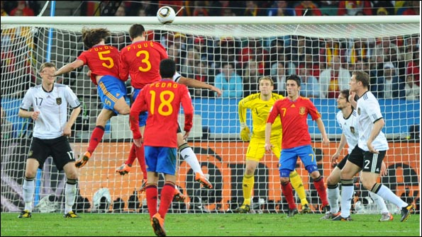 Puyol heads the winner for Spain