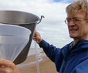 Nicholas Crane helping with an experiment to show the effect of the weather on sea levels
