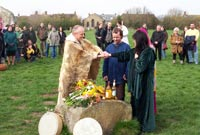 Two druids join a Pagan couple's outstretched hands in marriage at a circle of standing stones