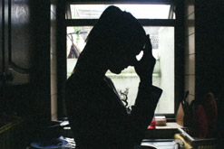 A silhouette of an unhappy-looking woman