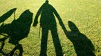 Shadows on the grass of a family
