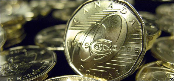 Commemorative one-dollar coins marking the 100th anniversary of the Montreal Canadiens NHL hockey team are seen Tuesday, March 10, 2009, in Montreal after they were unveiled by the Royal Canadian Mint