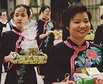 Women carrying gifts during the festival of Wesak in Manchester