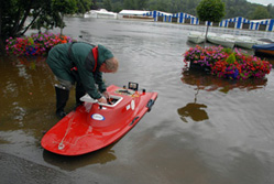 Man with rowboat in 2007 floods