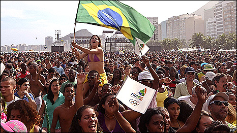 A Crowd Of People In The Streets Rio Celebrating