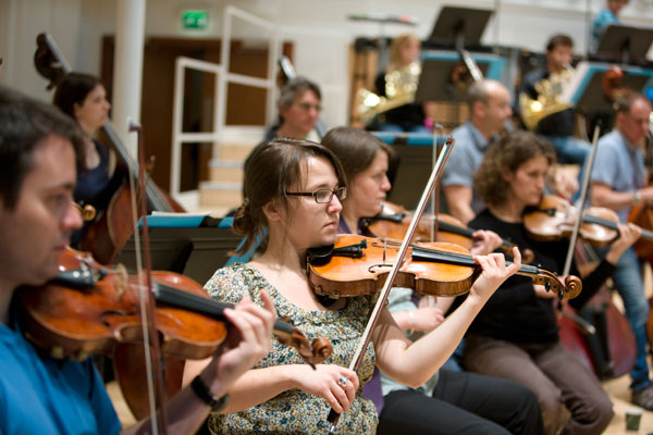 Amy Cardigan and some of the first violins of the BBC SSO