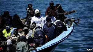 Migrants from Africa crowded into a small boat