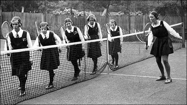 Sports mistress Betty Green giving some tennis training to young school girls at Northwood College, Middlesex in June 1934