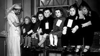 Very young evacuees prepare to travel, circa 1940. The experience was not always the exciting and jolly one that contemporary propaganda portrayed.