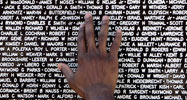 The hand of a visitor to the Vietnam Traveling Memorial Wall