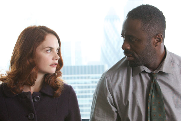 Detective Chief Inspector Luther, played by Idris Elba, sits with Alice Morgan, played by Ruth Wilson