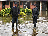 Harry Dunlop (left) in flooded yard