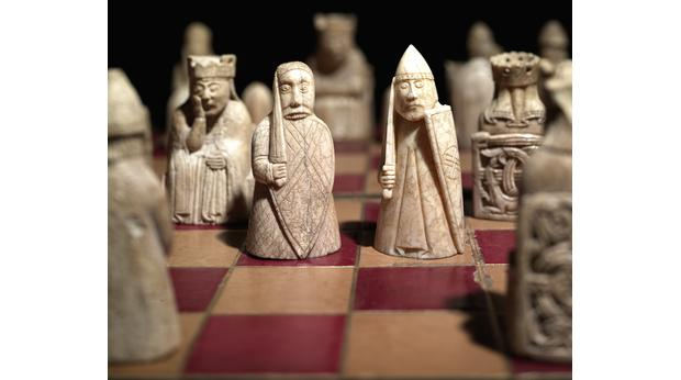 The Lewis Chessmen on a chess board. Copyright Trustees of the British Museum
