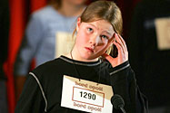 A girl at a spelling bee