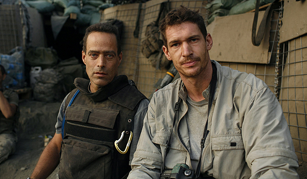 Photographer Tim Hetherington (R) and writer Sebastian Junger are shown in this undated handout image during an assignment for Vanity Fair Magazine at