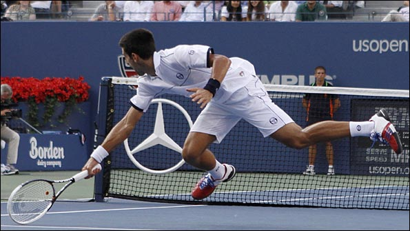 Djokovic reaches for another ball in the final against Nadal
