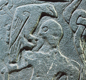 In one Viking story, the god Odin was attacked by the wolf Fenrir. This picture on the Thorwald Cross (Isle of Man) shows their battle.