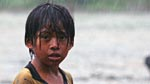 An achuar boy in the rain