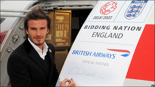 David Beckham prepares to board a plane for Zurich