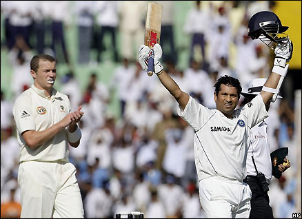 India's Sachin Tendulkar sets a new record for the most runs scored by a batsman in Tests