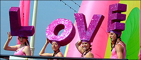 Revellers at Brighton Pride hold the word 'Love'.