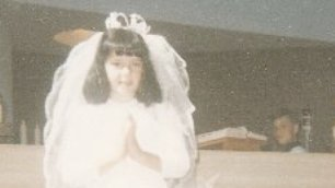 A young Liz Carr in her Holy Communion dress