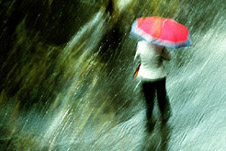 A person going in umbrella during heavy rain fall
