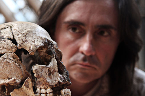 Neil Oliver looking at a skull