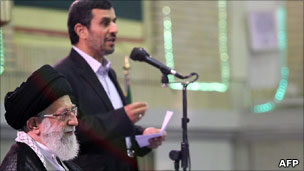 Ayatollah Khamenei listening to a speech by President Mahmoud Ahmadinejad