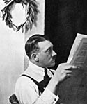 Adolf Hitler in December 1924. He sits reading a paper during his imprisonment in Landsberg Jail, after the failure of the Munich Putsch