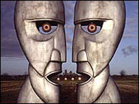 Album cover showing two metal head sculptures