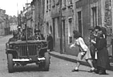 US jeeps and French civilians at Carentan, 1944